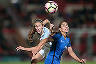 Amel Majri (France) watches the ball go behind her as Jill Scott (England) wins the header during the International Friendly match between England Women and France Women at the Keepmoat Stadium, Doncaster, England on 21 October 2016. Photo by Mark P Doherty.