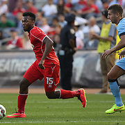 Daniel Sturridge, (left), Liverpool, challenged by Matija Nastasic, Manchester City, during the Manchester City Vs Liverpool FC Guinness International Champions Cup match at Yankee Stadium, The Bronx, New York, USA. 30th July 2014. Photo Tim Clayton