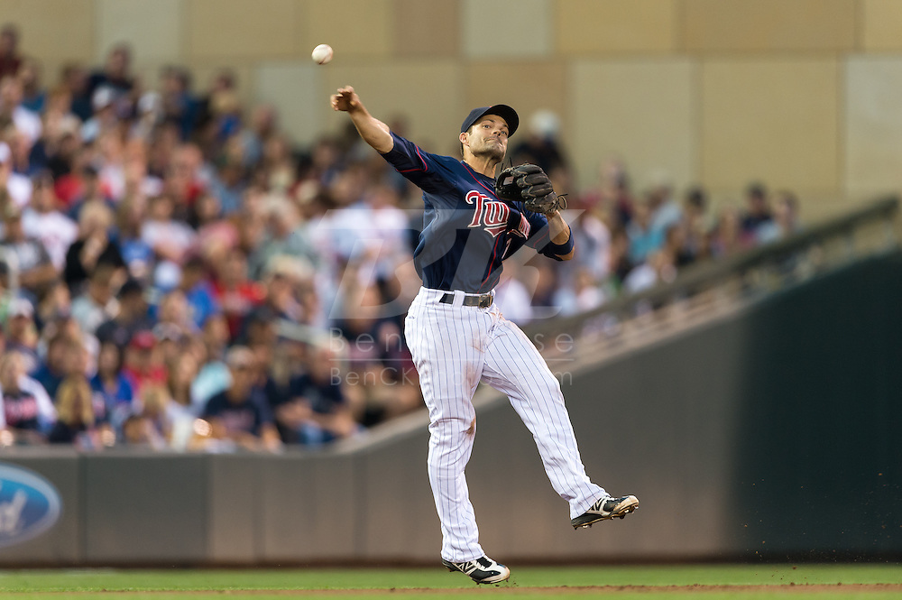 Jamey Carroll (8) of the Minnesota Twins makes a leaping throw to 1st base during a game against the Detroit Tigers on August 14, 2012 at Target Field in Minneapolis, Minnesota.  The Tigers defeated the Twins 8 to 4.  Photo: Ben Krause
