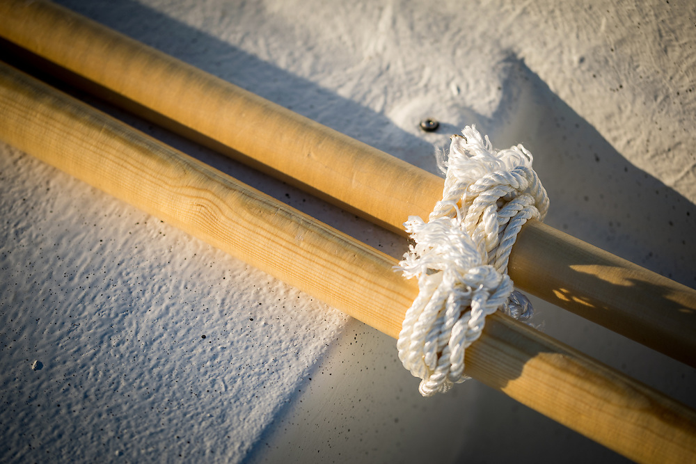 Rope tied around oars.