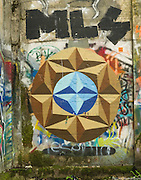 Street art painting in old mill building in Vernonia, Oregon depicting abstract blue and gold circle