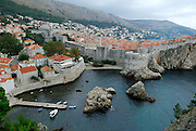 Elevated view from Fortress Lovrinjenac (Fort of Saint Lawrence) of Dubrovnik's oldest harbour, Kalarinja, Dubrovnik old town and Fortress Bokar