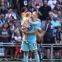 ST PAUL, MINNESOTA - JULY 18: Robin Lod #17 of Minnesota United kisses his daughter after the game against the Seattle Sounders at Allianz Field on July 18, 2021 in St Paul, Minnesota. Minnesota United defeated the Seattle Sounders 1-0.(Photo by Adam Bettcher/Getty Images) *** Local Caption *** Robin Lod