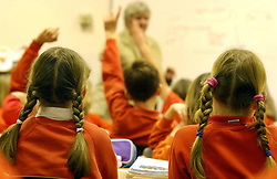 File photo dated 03/12/03 showing primary school children. According to a poll infant school children are taking mock SATs tests and being asked to revise at home for the assessments.