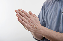 Man's clasped hands in prayer position, Bavaria, Germany