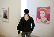 A man wears a Prince William mask as he visits the National portrait Gallery in London, following the wedding of Prince William to Kate Middleton in London, April 29, 2011.