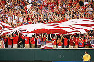July 18 2009: USA fans celebrate after a USA goal in extra time with a large american flag during the game between USA and Panama. The United States defeated Panama 2-1 in added extra time in a CONCACAF Gold Cup quarter-final match at Lincoln Financial Field in Philadelphia, Pennsylvania.