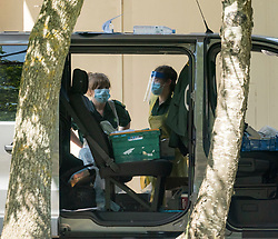 © Licensed to London News Pictures; 27/05/2020; Weston-super-Mare, UK. Staff some wearing PPE are seen working with a van at Weston General Hospital which has been closed to all new admissions including to A&E following an increase in cases of Covid-29 coronavirus being treated at the hospital. It's also reported that 40% of the hospital's staff have tested positive for coronavirus but many have no symptoms. Today mobile coronavirus test centre staffed by the army has opened in the town, to test for coronavirus during the Covid-19 pandemic. Photo credit: Simon Chapman/LNP.