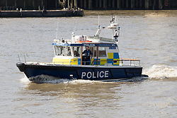 © Licensed to London News Pictures. 24/05/2017. LONDON, UK.  A reguar marine police patrol boat follows officers from the Metropolitan Police, including some armed officers board RIBs (Rigid Inflatable Boat) this morning as they leave their base on the River Thames.  The Marine Police Unit will be carrying out training exercises on the River Thames today, as the Metropolitan Police Serrvice has confimed it has increased police numbers in the capital in response to the increased terrorist threat. Photo credit: Vickie Flores/LNP