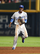 ATLANTA, GA - SEPTEMBER 02:  Shortstop Dee Gordon #9 of the Los Angeles Dodgers celebrates after doubling second baseman Dan Uggla #26 of the Atlanta Braves (not pictured) off of second base during the game at Turner Field on September 2, 2011 in Atlanta, Georgia.  (Photo by Mike Zarrilli/Getty Images)