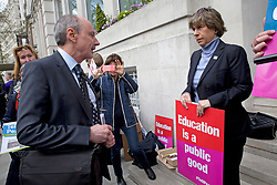 @ Licensed to London News Pictures. Rod Bristow (L), President of UK and Global Online Learning for Pearson Education speaking to protesters outside the companies Head Quarters in London on April 29, 2016. On August 19, 2020 it was announced nearly half a million UK pupils face a fresh round of results chaos after exam board Pearson pulled its BTec results on the eve of releasing them. Photo credit: LNP