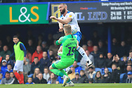 Aaron Wilbraham challenges the goalkeeper during the EFL Sky Bet League 1 match between Portsmouth and Rochdale at Fratton Park, Portsmouth, England on 13 April 2019.