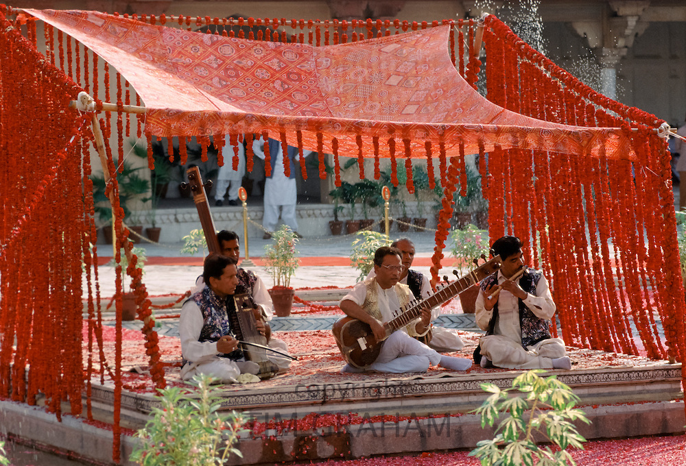 Musical band playing traditional instruments at festival in Lahore, Pakistan
