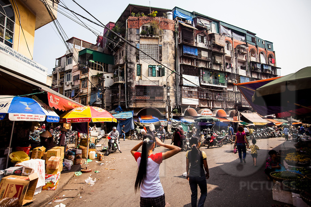 Weathered residential buildings next to Dong Xuan market, Vietnam, Southeast Asia