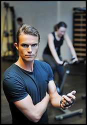 Celebrity Personal Trainer Matt Roberts training someone in his Gym in West London, Tuesday August 9, 2011. Matt trains the Prime Minister David Cameron amongst other celebrities.  Photo By Andrew Parsons