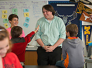 Matthew Sawyer works with his science students at Black Middle School, April 18, 2014.