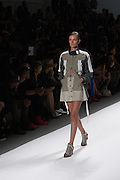 A tone-on-tone skirt  in sage green and tan with coordinated jacket by Richard Chai at the Spring 2013 Mercedes Benz Fashion Week show in New York.