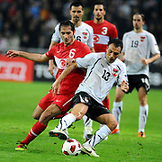Turkey's Hamit ALTINTOP (L) and Austria's Ekrem DAG (R) during their UEFA EURO 2012 Qualifying round Group A soccer match Turkey betwen Austria at Sukru Saracoglu stadium in Istanbul March 29, 2011. Photo by TURKPIX
