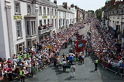 "© Licensed to London News Pictures. 13/07/2013<br /> <br /> Durham City, England, United Kingdom<br /> <br /> Thousands of people watch as colliery bands and banners march through the city of Durham during the Miners Gala.<br /> <br /> The Durham Miners' Gala is a large annual gathering held each year in the city of Durham. It is associated with the coal mining heritage of the Durham Coalfield, which stretched throughout the traditional County of Durham, and also gives voice to miners' trade unionism. <br /> <br /> Locally called ""The Big Meeting"" or ""Durham Big Meeting"" it consists of banners, each typically accompanied by a brass band, which are marched to the old Racecourse, where political speeches are delivered. In the afternoon a Miners' service is held in Durham Cathedral <br /> <br /> Photo credit : Ian Forsyth/LNP"