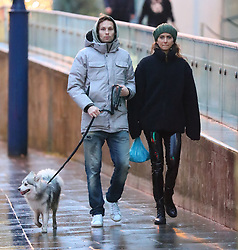 Manchester United's Daley Blind and fiance Candy Rae Fleur walk their dog in Manchester city centre on Thursday afternoon