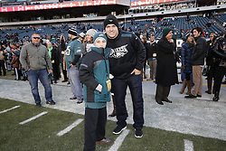 Los Angeles Angel Mike Trout poses for a picture with ab Eagles fan on the sideline before the NFL game between the Seattle Seahawks and the Philadelphia Eagles at Lincoln Financial Field in Philadelphia, Pennsylvania on Sunday December 7th 2014. The Seahawks won 25-14. (Brian Garfinkel/Philadelphia Eagles)