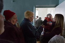 Olga Malishenko, 23, with her son Vladislav, 2yrs 7 months, at the Bolshaya Vergunka polyclinic.
