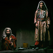 Portrait of Two Wakhi women, wearing everyday clothes. House of Bakh Shoh. The life of the Wakhi people, in the Wakhan corridor, amongst the Pamir mountains. Trekking with Paul Salopek.