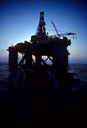 Stock photo of the silhouette of a semi-submersible rig