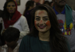 March 21, 2019 - Lahore, Punjab, Pakistan - Pakistani Hindu community throwing colours to each other to celebrate their religious festival Holi the Spring Festival of Colors at a temple (Karishna Mandir)  in Lahore. Holi marks the beginning of spring and the triumph of good over evil. Festivities include the throwing of colourful paint, powder and water on people. Holi observed in Pakistan at the end of the winter season on the last full moon of the lunar month. Hindus across the world and the provincial capital are celebrating Holi, a two-day religious festival. Special gatherings have been organised at various temples to celebrate the festival which began on March 20 and will end on March 21 (today).Known as the 'festival of colours', people from the Hindu community celebrate Holi by throwing coloured powder at each other and by exchanging gifts. Further, a great many gatherings are also arranged in homes while sweets are also distributed among revelers. (Credit Image: © Rana Sajid Hussain/Pacific Press via ZUMA Wire)
