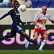 Jalil Anibaba, Chicago Fire, (left) and Joel Lindpere, New York Red Bulls, in action during the New York Red Bulls V Chicago Fire Major League Soccer regular season match at Red Bull Arena, Harrison. New Jersey. USA. 6th October 2012. Photo Tim Clayton