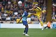Oxford United defender (on loan from Everton) Luke Garbutt (3) heads the ball  under pressure from Wycombe Wanderers striker (on loan from Millwall) Fred Onyedinma (19)during the EFL Sky Bet League 1 match between Wycombe Wanderers and Oxford United at Adams Park, High Wycombe, England on 15 September 2018.