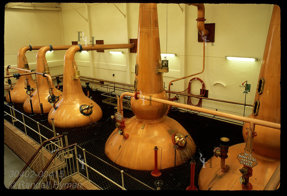 Copper pot stills line the wall @ Talisker Distillery, Scotland's most remote; Isle of Skye. Scotland