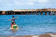 Hana, Maui: Georgia O'Keeffe's Island Fling: Maui, Hawaii. Families enjoying a sunny, Sunday afternoon in Hana Bay, Maui.