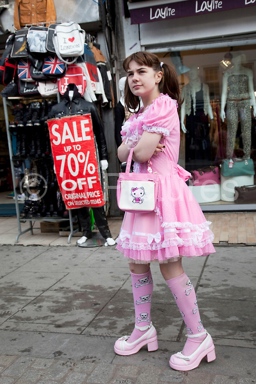 Georgia (11, wearing a pink Lolita dress) spending a day out together in Camden Town, North London. Louise (her mother) is on various benefits to help support her family income, and housing, although recent government changes to benefits may affect her family drastically, possibly meaning they may have to move out of London. Louise Ryan was born on the Wirral peninsula in 1970.  She moved to London with her family in 1980.  Having lived in both Manchester and Ireland, she now lives permanently in North London with her husband and two children. Through the years Louise has battled to recover from a serious motorcycle accident in 1992 and has recently been diagnosed with Bipolar Affective Disorder. (Photo by Mike Kemp/For The Washington Post)