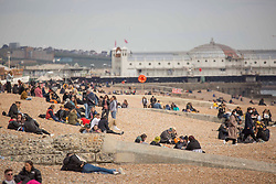 © Licensed to London News Pictures.  11/04/2021. Brighton, UK. Members of the public enjoy sunny afternoon in Brighton, east Sussex. Beer gardens are re-opening tomorrow  (Monday).  Photo credit: Marcin Nowak/LNP