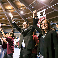 Navajo Nation Presidential Candidate Jonathan Nez and his wife Phefelia Herbert-Nez, right, walk with their supporters into the Window Rock Sports Complex. Nez, the current VP of Navajo Nation, won by a large margin in the primary elections. The field will now be between Joe Shirley Jr. and Jonathan Nez, two seasoned politicians who will face off in the upcoming general elections held in November.