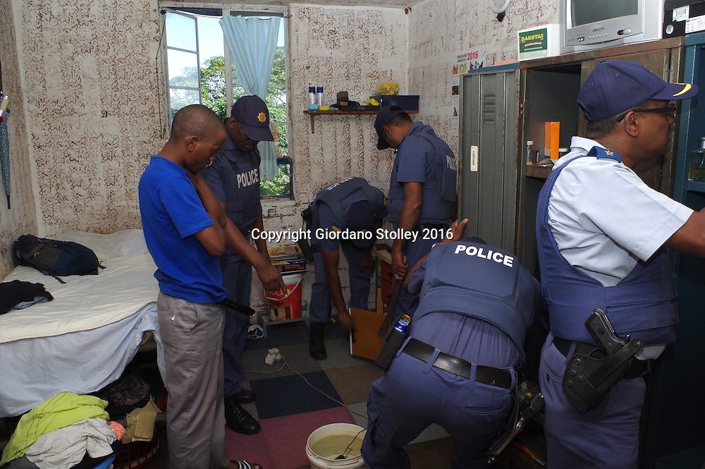 DURBAN - 13 May 2016 - Police officers search the room of a ressident (left, plain blue shirt) at Durban's notorious Glebelands Hostels. They were looking for weapons, drugs and stolen goods. Hundreds of police officers from Durban, the KwaZulu-Natal south coast, Pretoria and the eThekwini Metro Police forces converged on the violent Glebelands Hostels on the edge of Durban's Umlazi township, which have seen numerous shootings that have leftt at least 61 people dead and scores injured. Picture: Allied Picture Press/APP