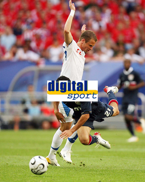 Photo: Chris Ratcliffe.<br /> USA v Czech Republic. Group E, FIFA World Cup 2006. 12/06/2006.<br /> David Rozehnal of Czech Republic clashes with Landon Donovan of the USA.