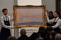 """© Licensed to London News Pictures. 03/03/2016. London, UK.  Claude Monet's """"Le Palais Ducal Vu De Saint-Georges Majeur"""" (sold for a hammer price of 10.2m), at Sotheby's Impressionist, Modern & Surrealist art evening sales in New Bond Street.  The combined total of the sale was forecast to realise between £97-138m. Photo credit : Stephen Chung/LNP"""