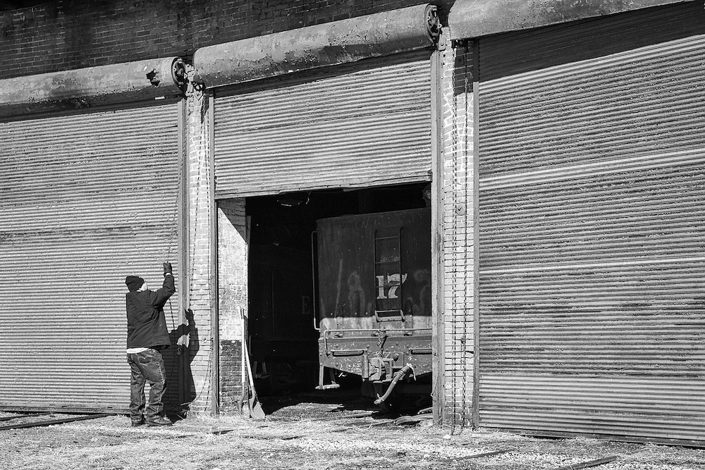An employee of the East Broad Top Railorad closes down the roundhouse.