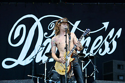 Justin Hawkins, lead vocals, of the English hard rock band The Darkness, the opening on the main stage, at T in the Park, Sunday 13/7/2003..Pic: © Michael Schofield.