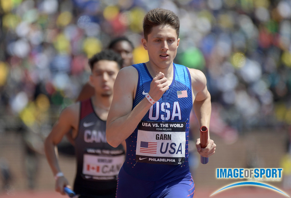 Apr 28, 2018; Philadelphia, PA, USA; Jesse Garn runs the  800m anchor leg of the USA sprint medley relay that won in 3:149.91 during the 124th Penn Relays at Franklin Field.
