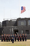 Union soldiers stand as the US flag is lowered at Fort Sumter on the 150th anniversary of the surrender of the fort in the US Civil War on April 14, 2011 in Charleston, South Carolina.  The surrender of the fort marks the end of a week long commemoration of the start of the Civil War.