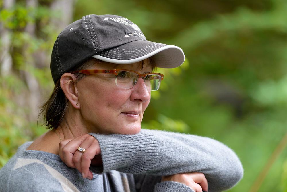 Portrait of a woman in a forest on Baranof Island, Alaska.