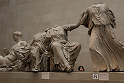 A visitor admires the sculpture of the ancient Greek Parthenons Elgin Marbles Metopes in the British Museum, on 11th April 2018, in London, England.