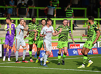 Football - 2020 / 2021 EFL League Two - Forest Green Rovers vs Bradford City<br /> <br /> Tempers flare as Forest Green Rovers' Ebou Adams disappears over the boards after he is pushed by Bradford City's Paudie O'Connor (centre) leading to the Bradford players red card, at the New Lawn Stadium<br /> <br /> COLORSPORT/ASHLEY WESTERN