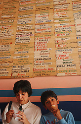 Corrina Pico and her son Carlos, 11, eat a few of the many weird and wondrous flavors available at the Coromoto ice cream parlor in Merida, Venezuela.  The shop, infamous for it's wacky flavors like tuna, meat, smoked trout, spaghetti with cheese and viagra, has been in the Guinness book of world records several times for having the most ice cream flavors in the world.  Tasting the ice cream before buying it is not allowed, so every customer is never sure what they will get.