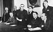 First meeting of Labour Supply Board set up in May 1940 by Churchill's government to organise labour for industrial war effort. Standing centre is the Chairman, Ernest Bevan (1881-1951) Minister of Labour and National Service.