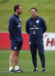 England head coach Gareth Southgate (left) and first team coach Steve Holland during a training session at St Georges' Park, Burton.
