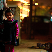 Father and daughter outside during Diwali